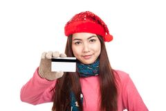 Asian girl with red christmas hat smile show credit card Royalty Free Stock Photography