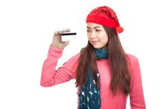 Asian girl with red christmas hat smile show credit card Royalty Free Stock Photos