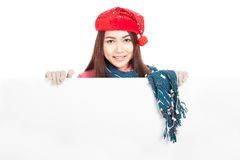 Asian girl with red christmas hat stand behind blank banner Stock Photos
