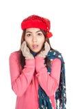 Asian girl with red christmas hat surprise lizenzfreie stockbilder