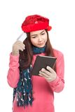 Asian girl with red christmas hat and tablet PC Stock Photo