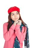 Asian girl with red christmas hat thinking of something Stock Photos