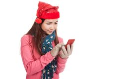 Asian girl with red christmas hat touch smart phone Stock Photography