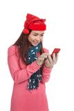 Asian girl with red christmas hat touch smart phone Stock Images