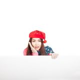 Asian girl with red christmas hat wonder with blank sign and cop Stock Images