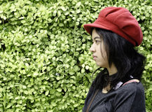 Asian girl with red hat on a background of green nature Royalty Free Stock Photography