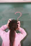 Asian girl with a red question mark Stock Images