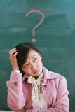 Asian girl with a red question mark Royalty Free Stock Photos