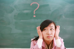 Asian girl with a red question mark Stock Image