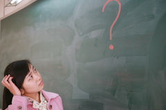 Asian girl with a red question mark Stock Photo