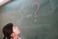 Asian girl with a red question mark Stock Photos