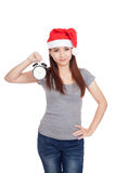 Asian girl with red santa hat and alarm clock Stock Photos