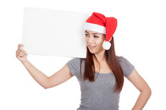 Asian girl with red santa hat hold a blank sign Stock Image