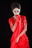 Asian girl  in a red transparent dress Royalty Free Stock Images