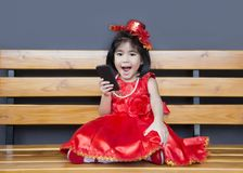Asina girl show mobile with red costume Royalty Free Stock Image