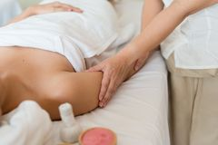 Asian girl relaxing having arm massage in a spa salon, close up stock photos