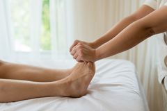 Asian girl relaxing having feet massage in a spa salon, close up Stock Images
