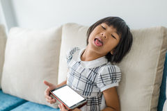 Asian girl relaxing at home. Stock Image