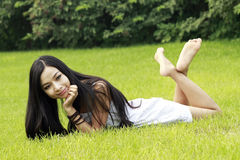 Asian girl relaxing outdoor. Royalty Free Stock Photos