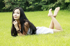 Asian girl relaxing outdoor. Stock Images