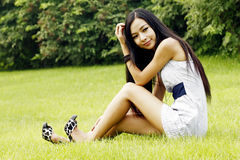 Asian girl relaxing outdoors Stock Photos