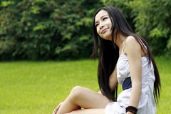 Asian girl relaxing outdoors Stock Image
