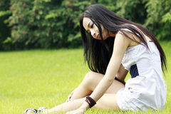 Asian girl relaxing outdoors Royalty Free Stock Image