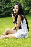 Asian girl relaxing outdoors Royalty Free Stock Photo