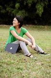 Asian girl relaxing in the park Royalty Free Stock Photography