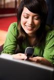asian girl relaxing texting Στοκ Εικόνες