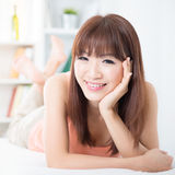 Asian girl resting on bed Royalty Free Stock Photography
