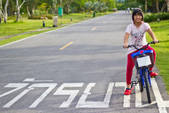 Asian girl riding bicycle Stock Photos