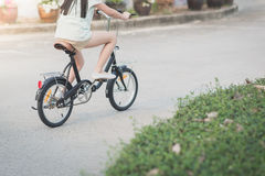 Asian girl riding a bike Royalty Free Stock Photo