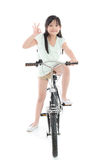 Asian girl riding a bike Royalty Free Stock Image