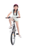 Asian girl riding a bike Stock Photography