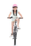 Asian girl riding a bike Royalty Free Stock Photography