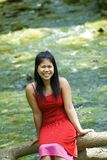 Asian girl and a river Stock Images