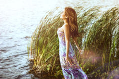 Asian girl on the river. Asian girl standing in a dress on the river Stock Photos