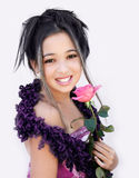 Asian girl with a rose. Asian girl with a pink rose Royalty Free Stock Image