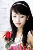 Asian girl and roses. Royalty Free Stock Photo