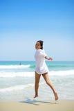 Asian girl running toward water Stock Photos