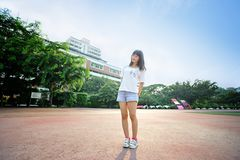 Asian girl on runway in school playground. Sexy girl, waistline, jeans, free to unrestrained Stock Images