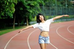 Asian girl on runway in school playground. Sexy girl, waistline, jeans, free to unrestrained Stock Photo