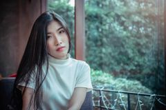 Asian girl`s looking at and siting in the room emotion royalty free stock image