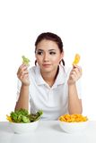 Asian girl with salad and crisps in her hands Royalty Free Stock Image