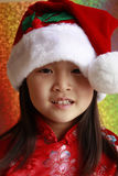 Asian Girl with Santa Hat Stock Image