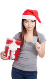 Asian girl with santa hat hold gift box show a card Stock Photo