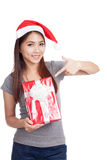 Asian girl with santa hat point to gift box Royalty Free Stock Photography