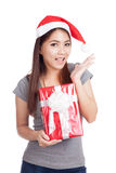 Asian girl with santa hat very happy  hold gift box Stock Images