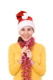 Asian girl in santa's hat Stock Photography